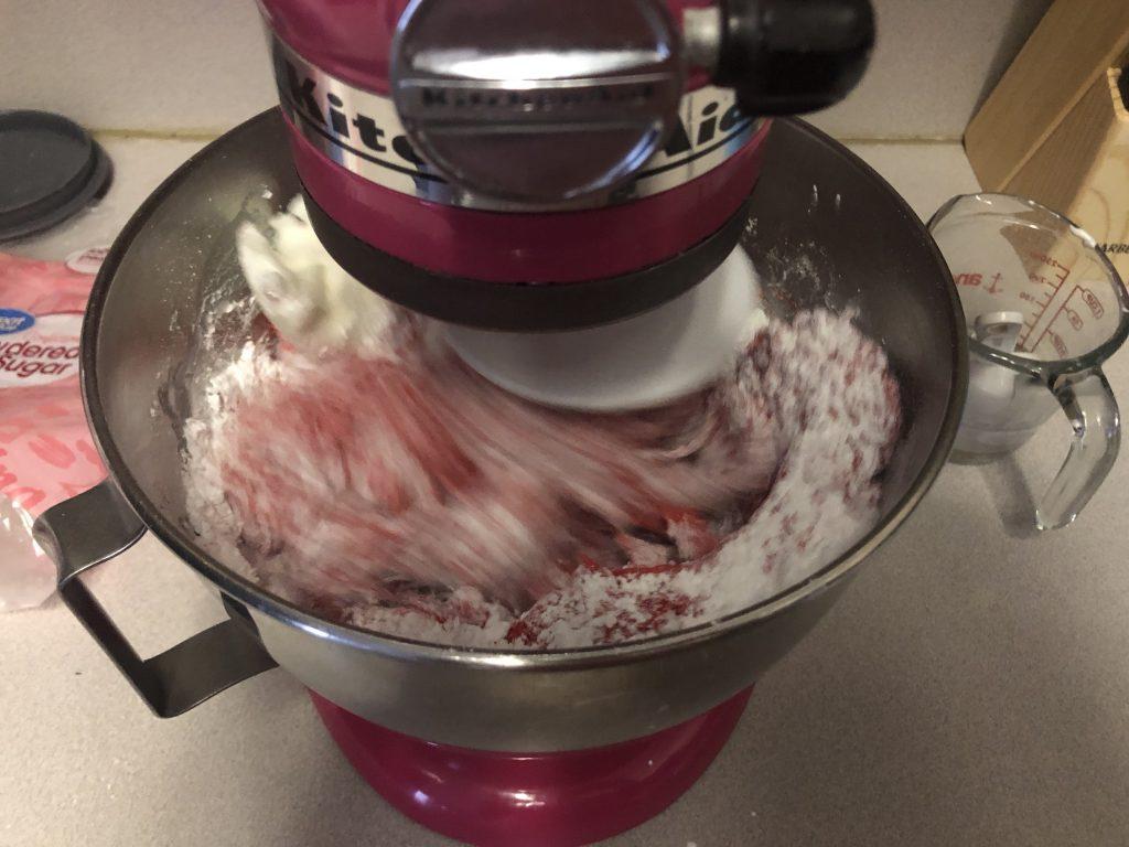 mixing powder sugar and melted marshmallows