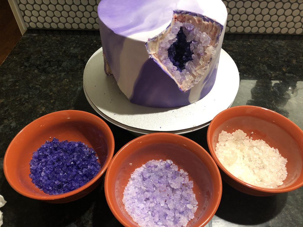 three shades of purple rock candy added to the cake